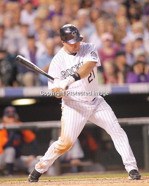 Colorado Rockies third baseman Ty Wigginton (21) swings at the pitch in a game against the Detroit Tigers.  The Rockies defeated the Tigers 5-4 on June 19, 2011 at Coors Field in Denver, Colorado. (AP Photo/Margaret Bowles)