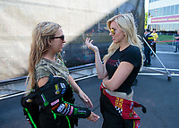 May 6, 2018; Commerce, GA, USA; NHRA funny car driver Courtney Force (right) talks with sister Brittany Force during the Southern Nationals at Atlanta Dragway. Mandatory Credit: Mark J. Rebilas-USA TODAY Sports