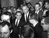 "United States President Lyndon B. Johnson and Governor George Wallace (Democrat of Alabama) are shown as they were mobbed by reporters in the White House Lobby in Washington, DC after their three hour meeting on March 13, 1965.  The President escorted the Governor through the lobby to waiting TV cameras where the Chief Executive and Wallace made brief statements.<br /> Credit: Benjamin E. ""Gene"" Forte / CNP"