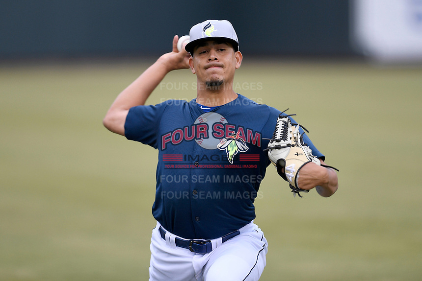 Starting pitcher Jose Butto (45) of the Columbia Fireflies warms up before a game against the Charleston RiverDogs on Friday, April 5, 2019, at Segra Park in Columbia, South Carolina. Charleston won, 6-1. (Tom Priddy/Four Seam Images)