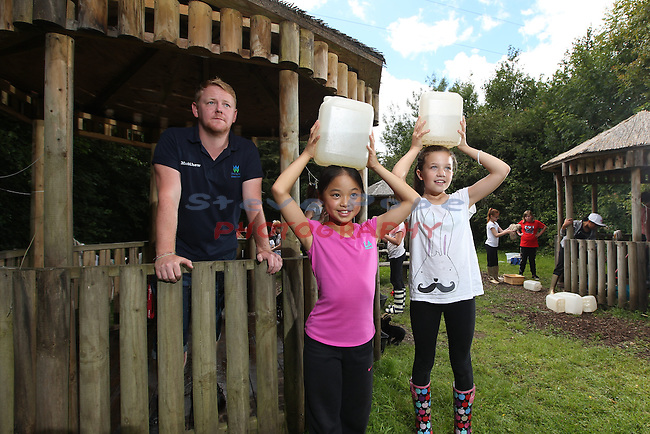 Coychurch Llangrallo Primary School visit to Welsh water Education Centre in Cilfynydd.<br /> Pupils Vivian Yip &amp; Olivia Lloyd with Welsh Water teacher Matthew Howells.<br /> 11.07.14<br /> &copy;Steve Pope-FOTOWALES