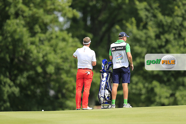 Luke Donald (ENG) and caddy John Mclaren on the 16th hole during Friday's Round 1 of the 2013 Bridgestone Invitational WGC tournament held at the Firestone Country Club, Akron, Ohio. 2nd August 2013.<br /> Picture: Eoin Clarke www.golffile.ie