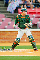 Catcher Shane Rowland #24 of the Miami Hurricanes looks a runner back to third base during the game against the Wake Forest Demon Deacons at Gene Hooks Field on March 18, 2011 in Winston-Salem, North Carolina.  Photo by Brian Westerholt / Four Seam Images
