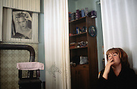 Bosnia and Herzegowina. Republika Serpska. Srebrenica. Amira Markovic is muslim and is married with a serb. She runs with her daughter a hairdressing salon. She smokes a cigarette. © 2005 Didier Ruef