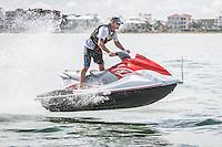 Andy Stevens on a waverunner from Bonita Jetski & Parasail at Doc's Beach House on Bonita Beach, Florida, UA. Photo by Debi Pittman Wilkey.