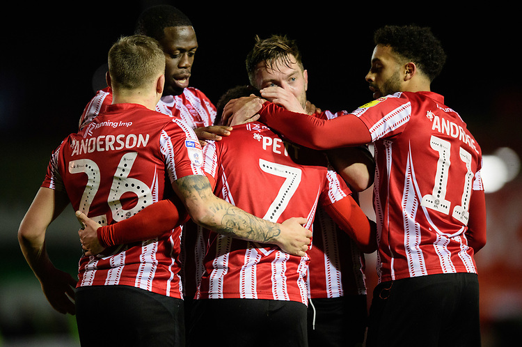 Lincoln City's Tom Pett, centre, celebrates scoring his side's third goal with team-mates<br /> <br /> Photographer Chris Vaughan/CameraSport<br /> <br /> The EFL Sky Bet League Two - Lincoln City v Newport County - Saturday 22nd December 201 - Sincil Bank - Lincoln<br /> <br /> World Copyright © 2018 CameraSport. All rights reserved. 43 Linden Ave. Countesthorpe. Leicester. England. LE8 5PG - Tel: +44 (0) 116 277 4147 - admin@camerasport.com - www.camerasport.com