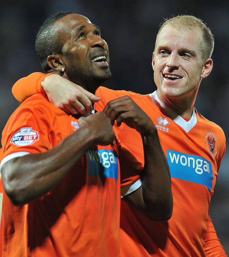 Blackpool's Ricardo Fuller is congratulated on scoring his team's first goal<br /> <br /> Photo by Dave Howarth/CameraSport<br /> <br /> Football - The Football League Sky Bet Championship - Huddersfield Town v Blackpool - Friday 27th September 2013 - The John Smith's Stadium - Huddersfield<br /> <br /> &copy; CameraSport - 43 Linden Ave. Countesthorpe. Leicester. England. LE8 5PG - Tel: +44 (0) 116 277 4147 - admin@camerasport.com - www.camerasport.com