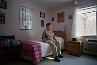 Seen here in her bedroom, Marilyn Davidson, 70, is high functioning and can speak.  She has lived in the Malone Park residences at the Fernald Center in Waltham, Massachusetts, USA, for 9 years, after living elsewhere on the campus before.  She likes to spend time looking and smiling in her mirror.