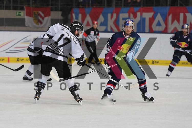 Eishockey, DEL, EHC Red Bull M&uuml;nchen - Thomas Sabo Ice Tigers N&uuml;rnberg. <br /> <br /> Im Bild Jon DiSALVATORE (14) (EHC Red Bull M&uuml;nchen) f&auml;ngt den Schu&szlig; von Patrick REIMER (17) (Thomas Sabo Ice Tigers) ab. <br /> <br /> Foto &copy; P-I-X.org *** Foto ist honorarpflichtig! *** Auf Anfrage in hoeherer Qualitaet/Aufloesung. Belegexemplar erbeten. Veroeffentlichung ausschliesslich fuer journalistisch-publizistische Zwecke. For editorial use only.