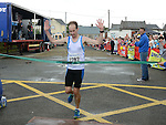 David Carrie crosses the line to win the Integral Clogherhead 10K. Photo:Colin Bell/pressphotos.ie