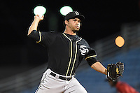 Omaha Storm Chasers pitcher Ramon Troncoso (24) delivers a pitch during the second game of a double header against the Nashville Sounds on May 21, 2014 at Herschel Greer Stadium in Nashville, Tennessee.  Nashville defeated Omaha 13-4.  (Mike Janes/Four Seam Images)