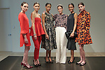 Creative Director Austyn Zung (third from right) poses with models during the Ann Taylor Fall Winter 2016 collection fashion presentation, at 7 Times Square on April 20, 2016.