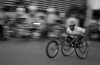 Year after year, races are faster as the athletes master better their wheelchairs better. Kompong Cham, Cambodia - 2009