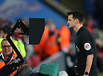 Referee Andy Madley consults the VAR pitch side screen which leas to a red card reversal during the Premier League match at Selhurst Park, London. Picture date: 1st February 2020. Picture credit should read: Paul Terry/Sportimage