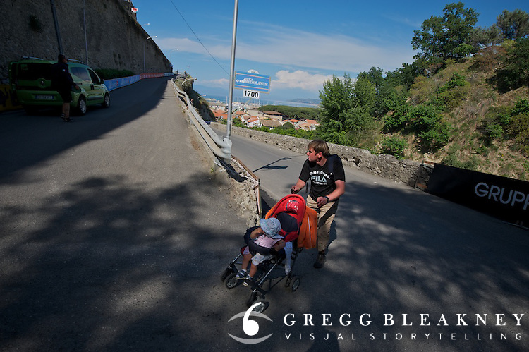 About an hour before Gatto made his winning attack on this hairpin corner, 1700 meters from the finish--another man covered ground at a slightly slower cadence.
