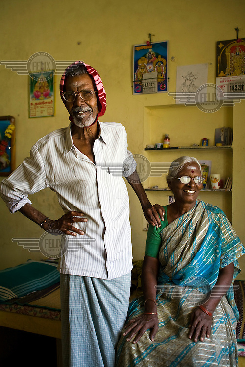 Ganapadi and his wife, Khrisaveni, in their room at the Tamaraikulam Elders' Village. The village is a pioneering experiment initially set up by HelpAge India after the Asian Tsunami to help elderly people displaced by the natural disaster. Today, the village is a self-sustaining community providing a family environment where more able-bodied residents assist the less able-bodied and provides 100 older people with a safe place to live, free healthcare, emotional security, a good diet and professional care and support...