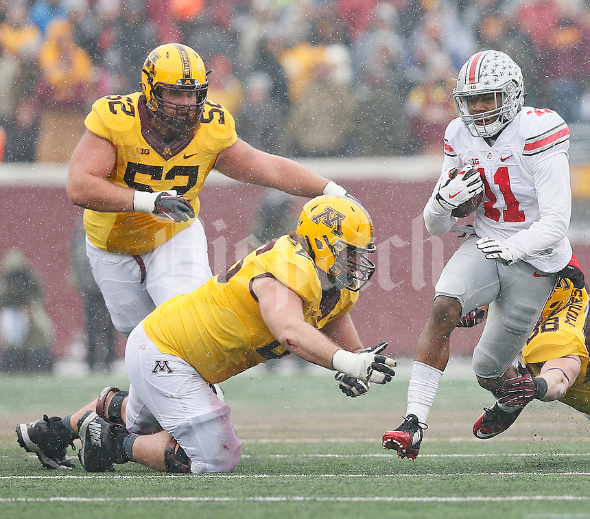Ohio State Buckeyes defensive back Vonn Bell (11) gains some yardage after picking off the ball in the second half at TCF Bank Stadium on November 15, 2014. (Chris Russell/Dispatch Photo)