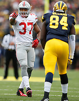 Ohio State Buckeyes linebacker Joshua Perry (37) lines up across from Michigan Wolverines tight end A.J. Williams (84) during the NCAA football game at Michigan Stadium in Ann Arbor on Nov. 28, 2015. Ohio State won 42-13. (Adam Cairns / The Columbus Dispatch)