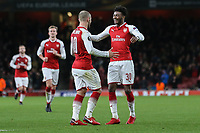 Jack Wilshere of Arsenal (2nd right) celebrates with Ainsley Maitland-Niles of Arsenal (right) after he scores his team's third goal of the game to make the score 3-0 during the UEFA Europa League match between Arsenal and FC BATE Borisov  at the Emirates Stadium, London, England on 7 December 2017. Photo by David Horn.