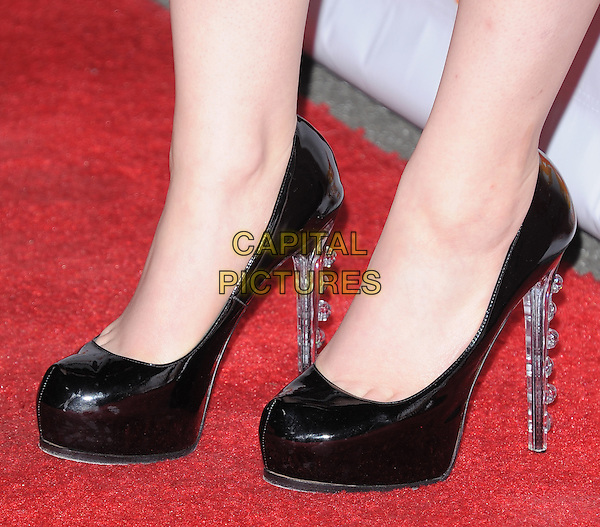 Kat Dennings' shoes.Trevor Live at The Hollywood Palladium in Hollywood, California, USA..December 4th, 2011  .detail feet heels clear .CAP/RKE/DVS.©DVS/RockinExposures/Capital Pictures.