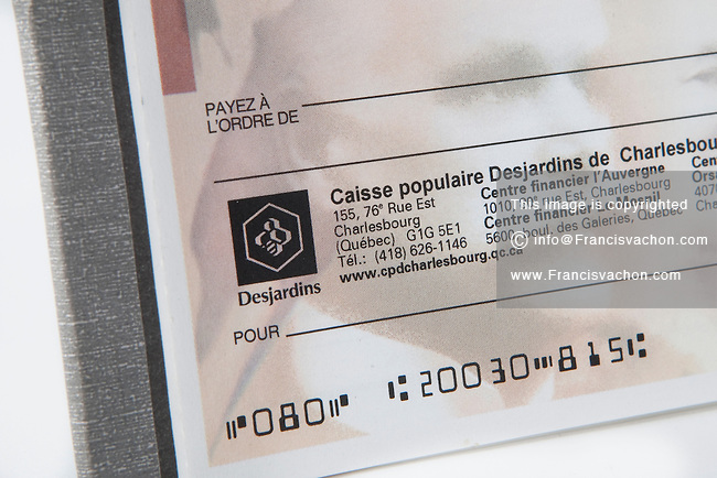 A Caisse Populaire Desjardins cheque over a white background.