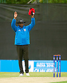 ICC World T20 Qualifier (Warm up match) - Canada V Western District Cricket Union select at Grange CC, Edinburgh - 6 signalled by Umpire Greg Brathwaite — credit @ICC/Donald MacLeod - 06.7.15 - 07702 319 738 -clanmacleod@btinternet.com - www.donald-macleod.com