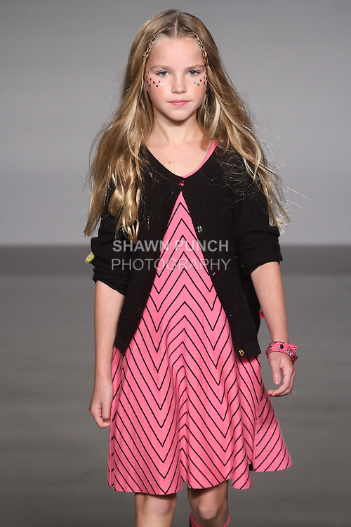 Model walks runway in an outfit from the LittleMissMatched collection, at the petitePARADE Spring 2016 fashion show.