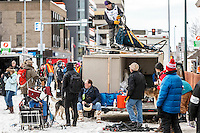 Ketil Reitan takes his sled off the roof of his dog truck in the staging area of  the Ceremonial Start of the 2016 Iditarod in Anchorage, Alaska.  March 05, 2016