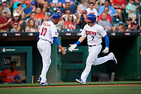 Buffalo Bisons manager Bob Meacham (10) congratulates Reese McGuire (7) after hitting a home run during an International League game against the Syracuse Mets on June 29, 2019 at Sahlen Field in Buffalo, New York.  Buffalo defeated Syracuse 9-3.  (Mike Janes/Four Seam Images)
