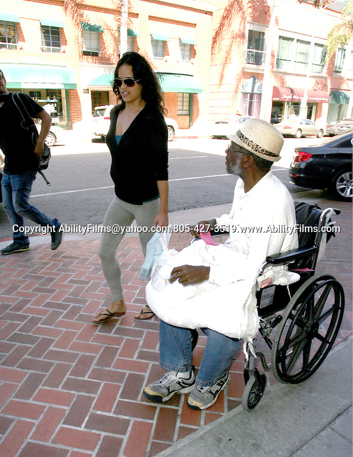 June 7th 2012 .....Michelle Rodriguez shopping in Beverly Hills trying to avoid a homeless man in a wheel chair ..AbilityFilms@yahoo.com.805-427-3519.www.AbilityFilms.com...