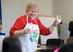 BEACON FALLS, CT-122717JS03----Jean Mai of Derby, knows as Science Snooper, Ms. Jean!, shows guests what happens when you mix vinegar and baking powder during her Kitchen Science show Wednesday at the Beacon Falls Public Library. The program showed children how science is everywhere, including the kitchen. <br /> Jim Shannon Republican-American