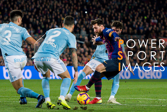 Lionel Andres Messi of FC Barcelona (2nd from R) fights for the ball with Jozabed Sanchez Ruiz (R), David Costas Cordal and Hugo Mallo Novegil of RC Celta de Vigo  during the La Liga 2018-19 match between FC Barcelona and RC Celta de Vigo at Camp Nou on 22 December 2018 in Barcelona, Spain. Photo by Vicens Gimenez / Power Sport Images