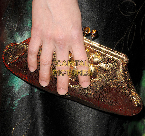 PARKER POSEY's bag.The 12th Annual Costume Designers Guild Awards held at The Beverly Hilton Hotel in Beverly Hills, California, USA. .February 25th, 2010 .hand black green pattern silk satin gold .CAP/RKE/DVS.©DVS/RockinExposures/Capital Pictures.