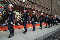 NEW YORK, NY - SEPTEMBER 11, 2016: Firefighters pay their respects at the at the (FDNY) Memorial Wall Located at FDNY Engine and Ladder 10 during the 15th anniversary of the 9/11 attacks on September 11, 2016 in New York. Photo by (VIEWpress/Maite H. Mateo)