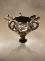 Bronze Age Anatolian terra cotta vessel with strainer - 19th to 17th century BC - Kültepe Kanesh - Museum of Anatolian Civilisations, Ankara, Turkey.  Against a warn art background.