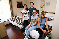 Pictured: Home owner Amanda Hopkins (FRONT) with three of her four children, Morganne, 24 (3rd L) and Rowan 13 (C)(3rd L) in the one bed Ynyscedwyn Arms B&amp;B room that they are staying temporarily in nearby Ystradgynlais. Thursday 31 August 2017<br /> Re: Home owners and tennants have been served to evacuation orders by Neath Port Talbot County Council over fears that a landslip has made their houses unsafe in Cyfyng Road, Ystalyfera, Wales, UK.