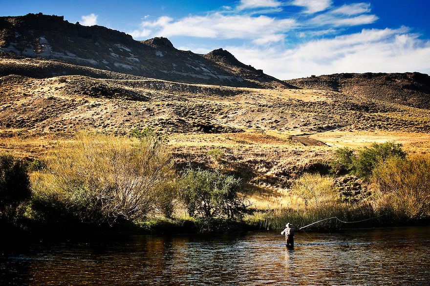 An angler fishes on Rio Chimehuin in northern Patagonia near Junin de los Andes, Argentina.