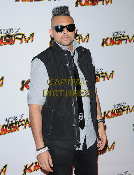 Sean Paul.attends the 102.7 KIIS FM Jingle Ball 2011 held at The Nokia Theater Live in Los Angeles, California, USA,  December 3rd 2011..arrivals half length sunglasses  shirt tie bodywarmer grey gray black hair spiked up                   .CAP/RKE/DVS.©DVS/RockinExposures/Capital Pictures.