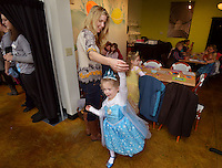 STAFF PHOTO BEN GOFF  @NWABenGoff -- 12/06/14 Rebecca Woodlin of Bentonville twirls her daughter Morgan Woodlin, 3, after visiting the princess photo booth during Trike Theatre's Princess Winter Wonderland Brunch at Tavola Trattoria in Bentonville on Saturday Dec. 6, 2014. Participants came dressed up in princess outfits and had brunch, made crafts and had their picture taken with two grown-up princesses.