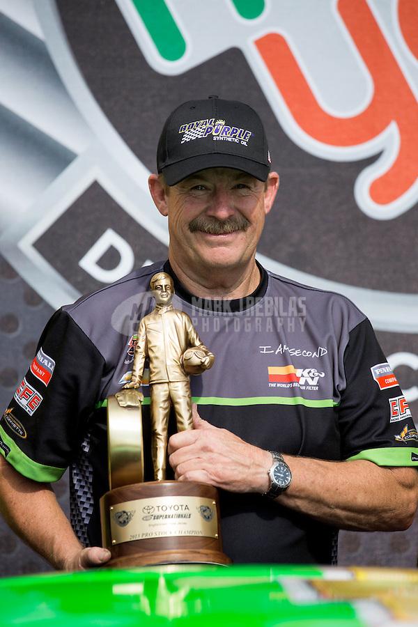 Jun. 2, 2013; Englishtown, NJ, USA: NHRA pro stock driver Mike Edwards celebrates after winning the Summer Nationals at Raceway Park. Mandatory Credit: Mark J. Rebilas-