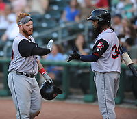 NWA Democrat-Gazette/ANDY SHUPE<br /> Arkansas Travelers catcher Tyler Marlette is congratulated Saturday, June 10, 2017, by right fielder Keury De La Cruz after htting a two-run home run during the fifth inning against the Northwest Arkansas Naturals at Arvest Ballpark in Springdale. Visit nwadg.com/photos to see more photographs from the game.