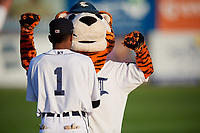 Connecticut Tigers center fielder Isrrael De La Cruz (1) jokes around with mascot C.T. the Tiger before a game against the Hudson Valley Renegades on August 20, 2018 at Dodd Stadium in Norwich, Connecticut.  Hudson Valley defeated Connecticut 3-1.  (Mike Janes/Four Seam Images)