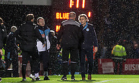 Wycombe Wanderers Manager Gareth Ainsworth shakes hands with Manager Paul Cook of Portsmouth post match during the Sky Bet League 2 match between Wycombe Wanderers and Portsmouth at Adams Park, High Wycombe, England on 28 November 2015. Photo by Andy Rowland.