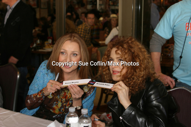Donna Murphy and Bernadette Peters at The 26th Annual Broadway Flea Market and Grand Auction to benefit Broadway Cares/Equity Fights Aids on September 23, 2012 in Shubert Alley and Times Square, New York City, New York.  (Photo by Sue Coflin/Max Photos)