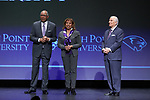 (L-R) High Point Panthers men's basketball head coach Tubby Smith, his wife, Donna Smith, and High Point University President Dr. Nido Qubein during a presentation at the Hayworth Fine Arts Center on the campus of High Point University on March 27, 2018 in High Point, North Carolina.  (Brian Westerholt/Sports On Film)