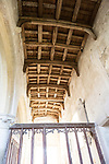 Building interior medieval church architectural feature, Inglesham, Wiltshire, England wooden roof beams low angle view looking up from below