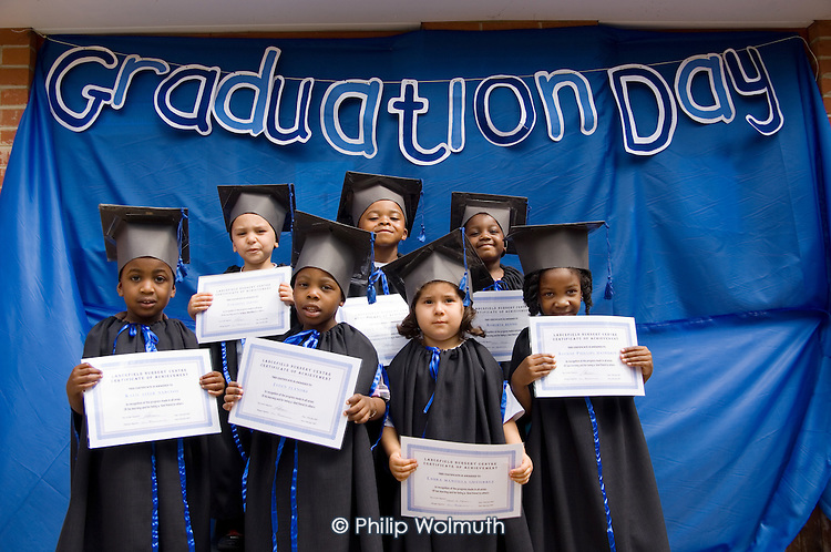 Children, dressed in academic gowns and mortar boards,  'graduating' from Lancefield Nursery with their leaving certificates.