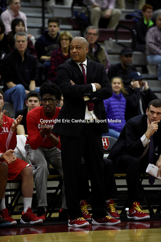 Friday, January 29, 2016: Cornell Big Red head coach Bill Courtney watches the action on the court during the NCAA basketball game between the Cornell Big Red and the Harvard Crimson held at the Lavietes Pavilion in Boston, Massachusetts.  Cornell defeats Harvard 65-77. Eric Canha/CSM