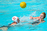 LOS ANGELES, CA - MAY 13: Paige Hauschild #5 of the University of Southern California attempts a pass over Makenzie Fischer #11 of Stanford University during the Division I Women's Water Polo Championship held at the Uytengsu Aquatics Center on the USC campus on May 13, 2018 in Los Angeles, California. USC defeated Stanford 5-4. (Photo by Tim Nwachukwu/NCAA Photos via Getty Images)