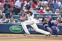 Atlanta Braves center fielder Cameron Maybin (25) swings at a pitch during a game against the Chicago Cubs on July 18, 2015 in Atlanta, Georgia. The Cubs defeated the Braves 4-0. (Tony Farlow/Four Seam Images)